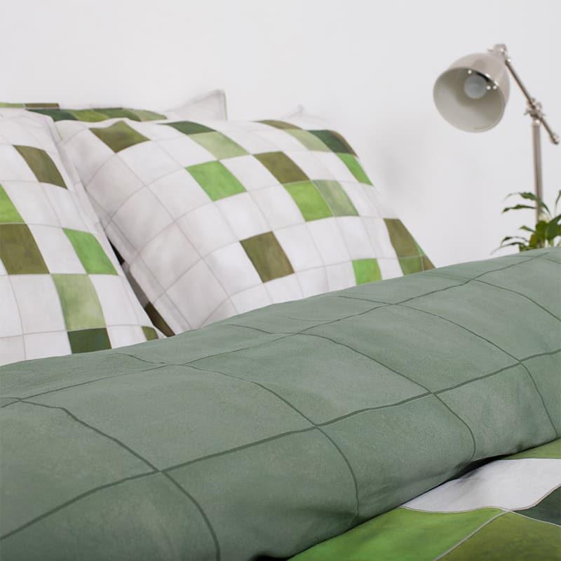 dekbedovertrek van dichtbij in de kleuren wit en groen