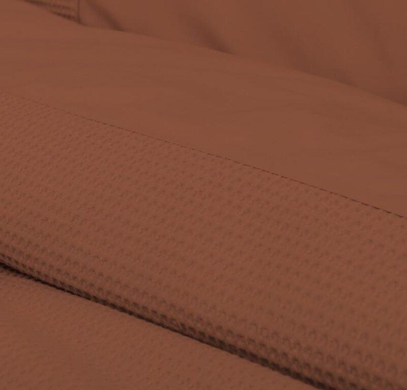 terra kleurig stuk van een dekbedovertrek in wafelstructuur