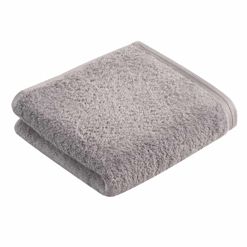 opgevouwen effen grijze handdoek - luxe handdoeken