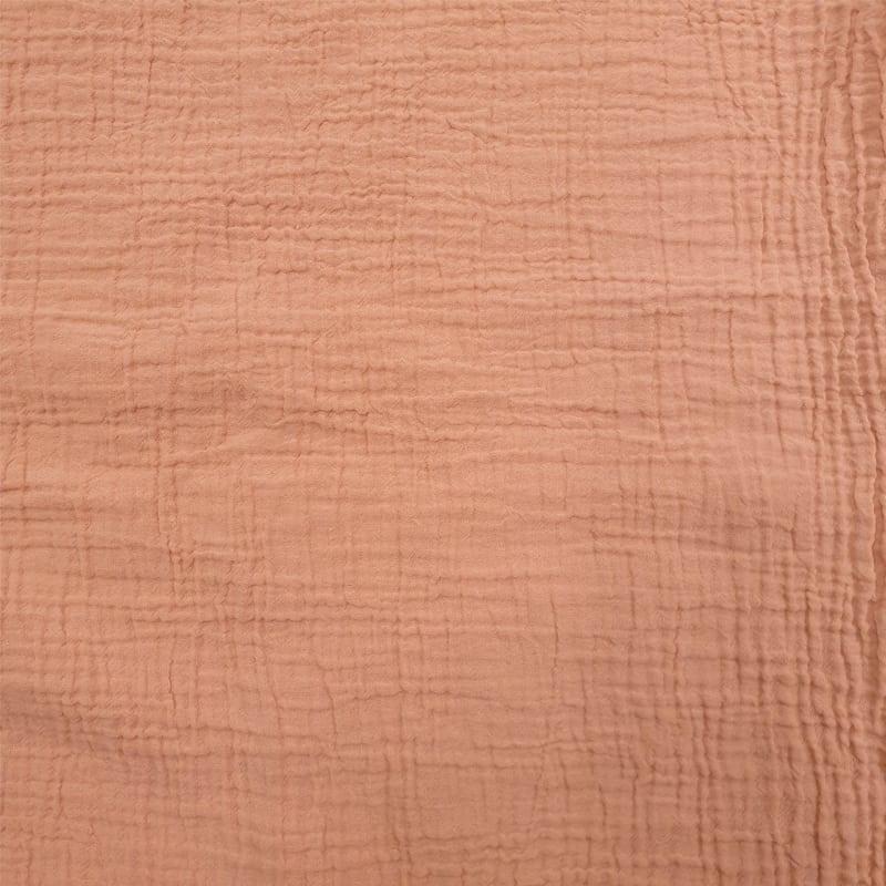 coral kleurige stof van biologisch dekbedovertrek